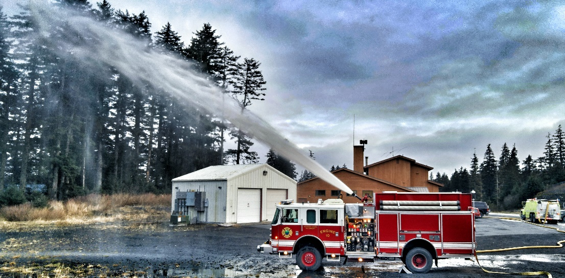 Photo of fire truck spraying water